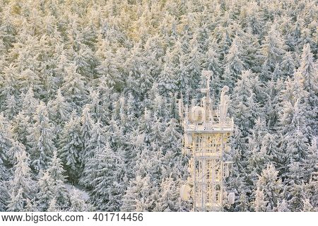 Telecommunication Tower In The Middle Of A Snowy Forest