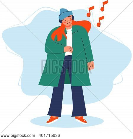 Girl In A Coat Listens To Music With Headphones, Enjoying Music. Listening To Music Or Audiobook Wit