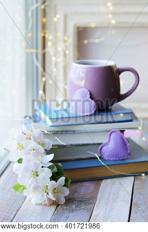 A Cup Of Coffee, A Stack Of Book, Hearts And Apple Flowers On A Wooden Windowsill, Spring, The Conce