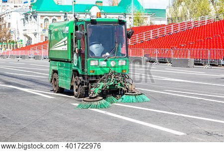 Samara, Russia - May 1, 2019: Street Sweeper Machine Cleans Street With Brushes And Water