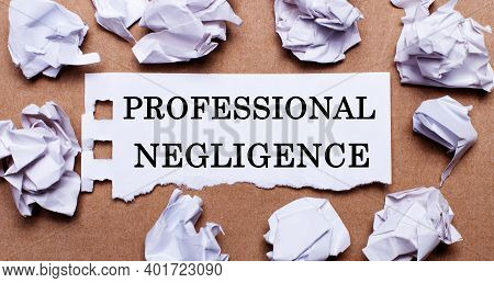 Professional Negligence Written On White Paper On A Light Brown Background.