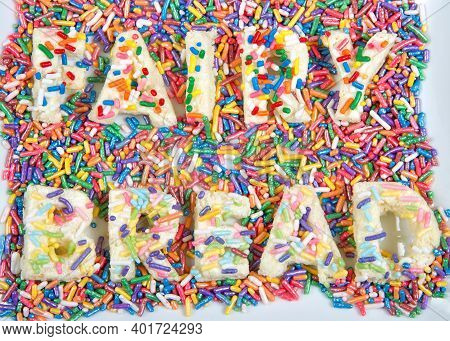 Fairy Bread Spelled With Fairy Bread On Rectangular Plate, With Candy Sprinkles Spilled About. Fairy