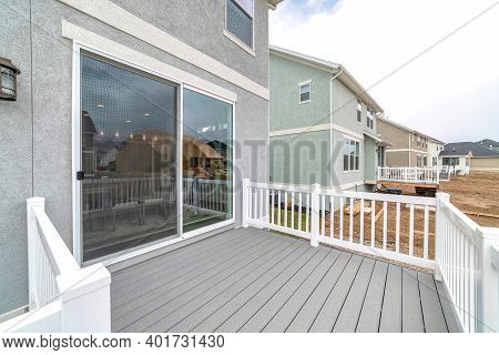 Sliding Glass Door At The Deck Of Home With Scenic View Of The Neighborhood