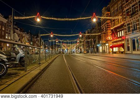 Christmas on the Damrak in the Netherlands at night
