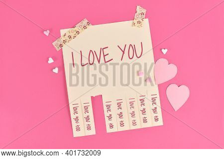 Valentine's Day Tear Off Stub Note With Text 'i Love You' And Reply 'i Love You Too' On Pink Backgro