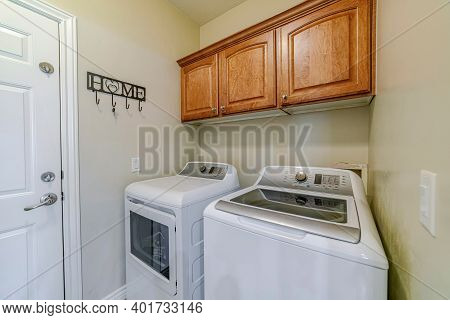Laundry Appliances Inside Small And Functional Utility Room Of Residential Home
