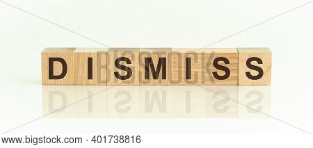 Wooden Blocks With The Text: Dismiss. The Text Is Written In Black Letters And Is Reflected In The M