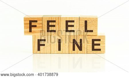 Feel Fine Written On A Wooden Cube. Feel Fine - Text On Wooden Cubes On A White Background, Concept