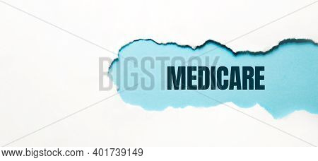 Medicare Word Made On Torn Papper, Medical Concept Background