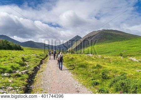 Group Of Hikers In Cronins Yard On The Trail To Devils Ladder To Climb The Highest Mountain In Irela
