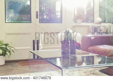 Natural Sunlight Shines Through The Window To A Modern Conservatory Room Interior In The Morning