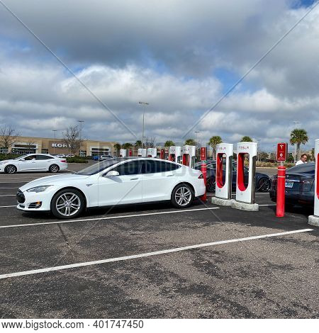 Cars Charging At A Tesla Supercharger Station In Florida.