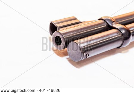 The Muzzle And Magazine Extension Tube Of A 30-30 Caliber Hunting Rifle On A White Background