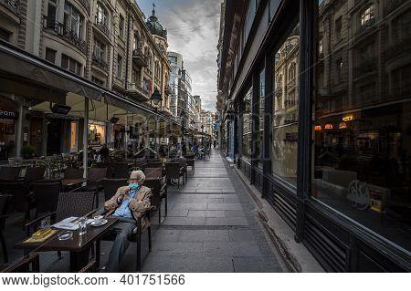 Belgrade, Serbia - May 12, 2020: Old Senior Man Wearing A Respiratory Face Mask Sittting At The Terr