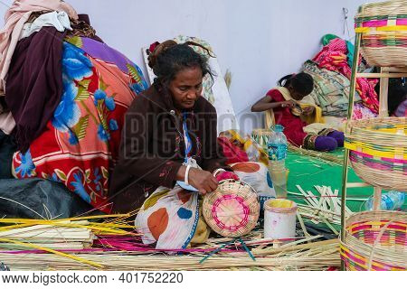 Kolkata, West Bengal, India - 31st December 2018 : Senior Bengali Woman Making Wicker Baskets For Sa