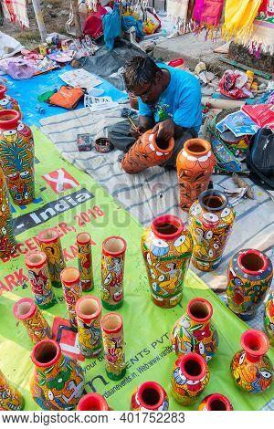 Kolkata, West Bengal, India - 31st December 2018 : Bengali Artist Man Painting Colors On Terracotta
