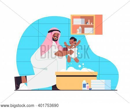 Arab Father Bathing Little Son In Bath Tub Fatherhood Parenting Concept Dad Spending Time With Baby