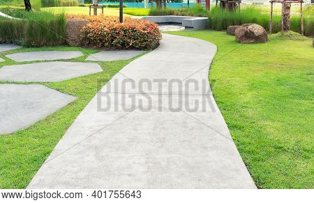 Walkway And Bush In Garden.  For Walking Along And Decorative Park, Garden.