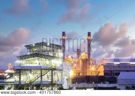 Gas Fired Power Plant And Factory Building At Night. Also Called Gas Fired Power Station Or Natural