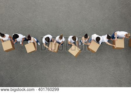 Volunteers Move Boxes To A Truck For Shipment