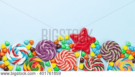 Various candy sweets and lollipop. Top view flat lay with copy space