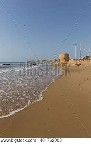 La Mata Spain Costa Blanca With Famous Tower Landmark Beach And Waves