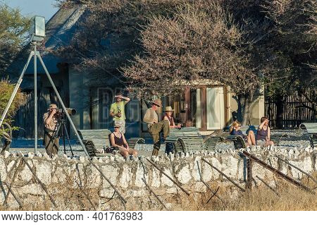 Etosha National Park, Namibia - June 13, 2012: Tourists At The Waterhole Viewpoint At Okaukeujo Rest