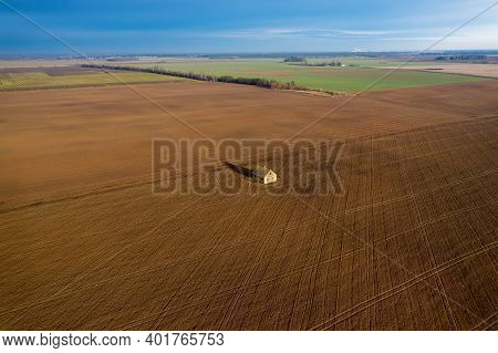 Lonely House In The Middle Of An Empty Field Top View. Self-isolation In A Private House.