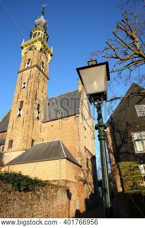 The Stadhuis (town Hall) With Its Impressive Clock Tower Viewed From An Alley In Veere, Zeeland, Net