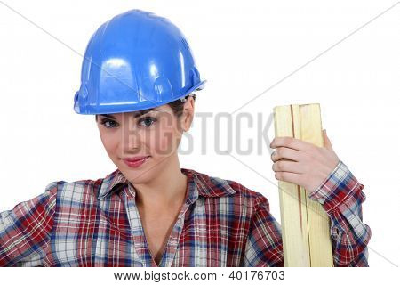 Tradeswoman holding a plank of wood