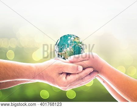 International Day Of Peace Concept: Children Hands Holding Earth Global Over Blurred Abstract Nature