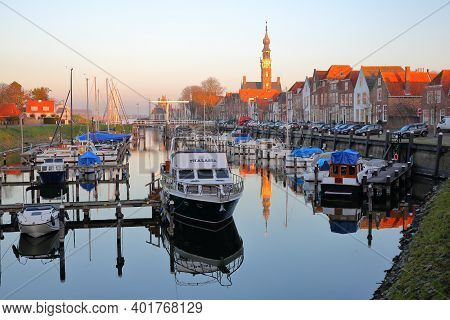 Veere, Netherlands - December 10, 2020: The Marina (harbor) And Historic Buildings With The Clock To