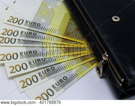 Background From Banknotes In Denominations Of 100 And 200 Euros. Euro Money Fanned Out In A Close-up
