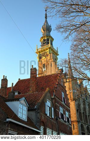 The Gothic Stadhuis (town Hall) With Its Impressive Clock Tower, Located At The Main Square (markt)