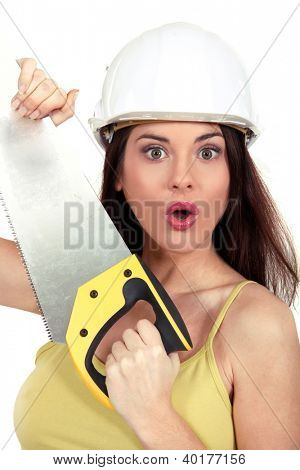 Surprised woman with a handsaw