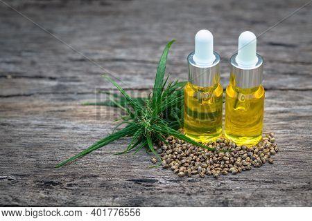 Cbd Oil Hemp Products, Cannabis Extract Oil On A Wooden Table, Medical Marijuana.