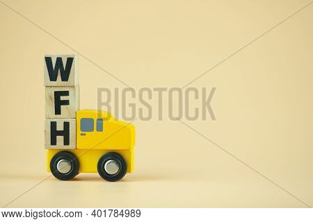 Wooden Block Word Of Wfh On Toy Pickup Truck. Concept Of Work From Home During The Coronavirus Crisi