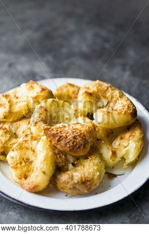 Close Up Of Crispy Golden Baked Smashed Potatoes