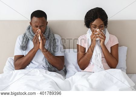 Sick African American Man And Woman Got Coronavirus, Sneezing Their Noses, Staying In Bed During Ill