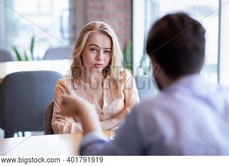Bad Date. Young Woman Feeling Bored During Dinner At Cafe, Unhappy With Her Boyfriend, Disinterested