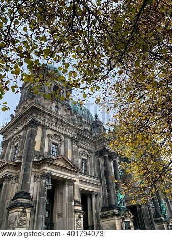 Low Angle Side View Of The Berlin Cathedral In Autumn. Berliner Dom - Famous Church And Dynastic Tom