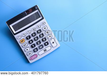 Calculator Keypad On A Blue Background. Top View. Copy Space