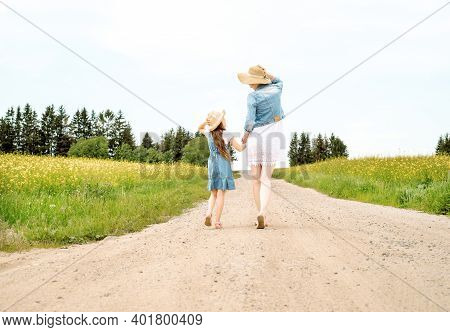 Mother Woman Little Girl My Daughter Go On Rural Road Through Green Field In Summer.yellow Field, Su