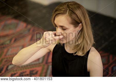 Breathing With A Change Of Nostril. Middle Aged Woman Doing Breathing Exercises Yoga, Meditation, Pr