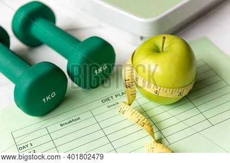 Close Up Green Apple With Measuring Tape .  Diet Health Plan.  Nutrition Start Up Workout Planing. S