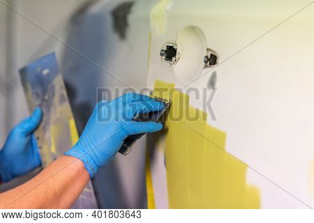Preparation For Painting A Car Element Using Emery Sender By A Service Technician Leveling Out Befor