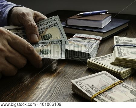 Hands Are Counting Wads Of Money. Payday Cash Loan.