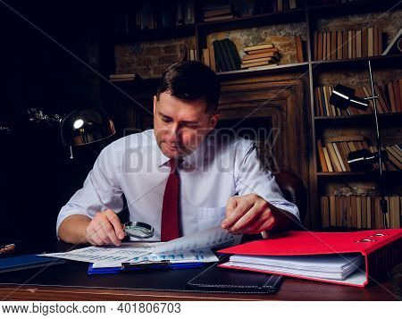The Auditor Does An Audit Of The Company Financial Statements Late At Night.