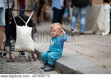 Brno, Czech Republic. 06-11-2016. Children Sitting On The Sidewalk Attending A Festival Of Roma Peop