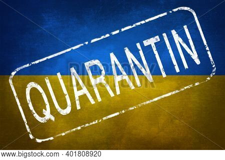 The Stamp Quarantin Against The Background Of The Flag Of Ukraine. Quarantine During The Covid-19 Co